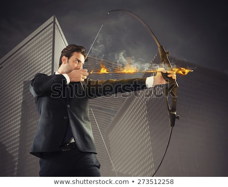 Businessman takes aim at a target with bow and arrow Stock photo © Kirill_M
