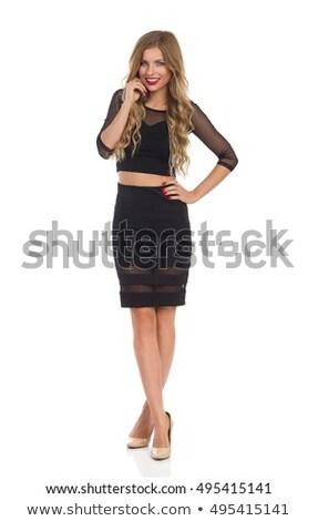 alegre · atraente · vestido · preto · posando · preto - foto stock © wavebreak_media