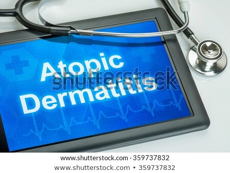 Tablet with the diagnosis Atopic Dermatitis on the display Stock photo © Zerbor