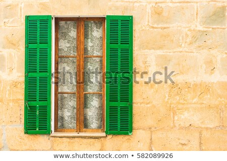 brown wooden window shutters on the old stone house stock photo © smuki