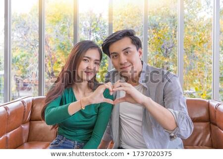young asian happy groom gesturing stock photo © rastudio