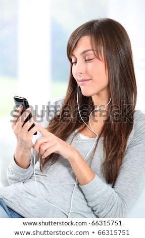 女性 mp3プレーヤー 笑みを浮かべて 技術 都市 ヘッドホン ストックフォト © IS2