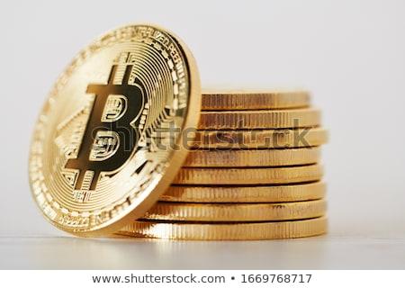 Golden bitcoins in set stock photo © studioworkstock