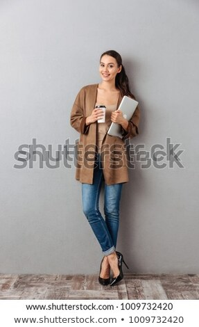 Business woman full of thoughts Stock photo © hsfelix