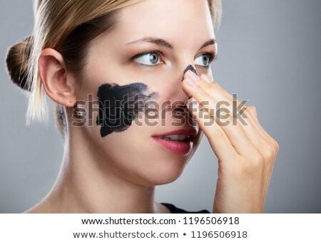 Vrouw houtskool masker gezicht portret Stockfoto © AndreyPopov