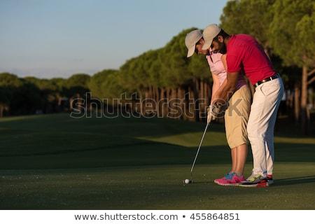 Istruttore insegnamento femminile maschio golf Foto d'archivio © Kzenon