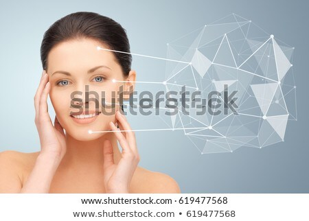 young woman with skin pointers and low poly shape Stock photo © dolgachov