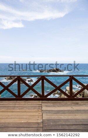 Wooden fence on the pier at Caribbean sea Stock photo © boggy