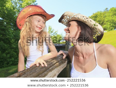 mother cowgirl with his daughter Stock photo © Lopolo
