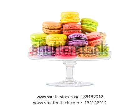 lemon yellow macarons on glass confectionery stand Stock photo © dolgachov