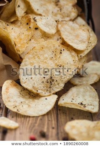 Ziemniaczanej chipy przekąska czarny pieprz stali wiadro Zdjęcia stock © DenisMArt