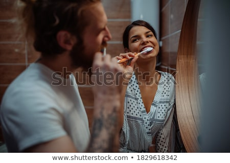 Young man in a shared bathroom Stock photo © photography33