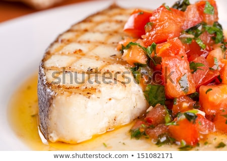 Stock photo: fish slices served with tomato and olives, and lemon