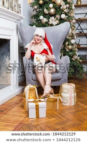 Blonde vrouw tank top Rood rok Stockfoto © dash