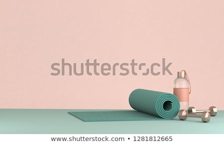 Woman with dumbbells and yoga mat  Stock photo © HASLOO