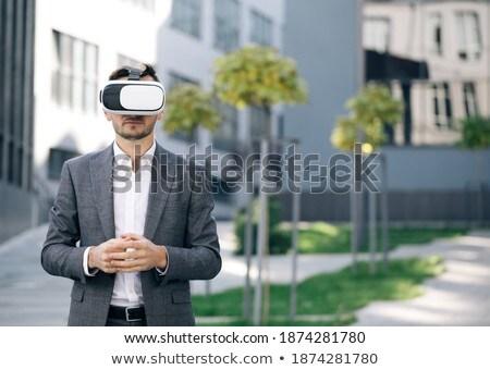 Man smiling at something in virtual headset Stock photo © ozgur