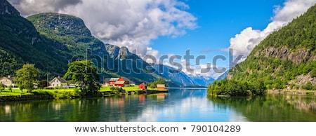 Reflexão montanhas Noruega azul água céu Foto stock © compuinfoto