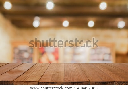 Coffee and food on wooden table in cafeteria Stock photo © wavebreak_media