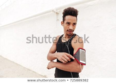 濃縮された スポーツ 男 屋外 見える 携帯電話 ストックフォト © deandrobot