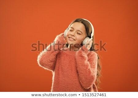 nina · auriculares · disfrutar · música · mano · nino - foto stock © goce