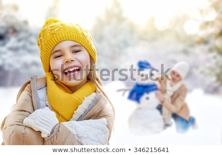 Family Sculpting Snowman in Winter Park on Holiday Stock photo © robuart
