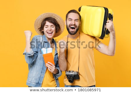 happy couple with air tickets and passport Stock photo © dolgachov