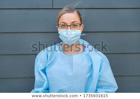 Portré nő szemüveg néz kamera mosolyog Stock fotó © ruslanshramko
