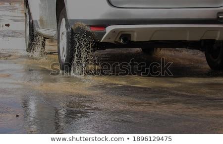 Teherautó pocsolya út tájkép utazás homok Stock fotó © olira