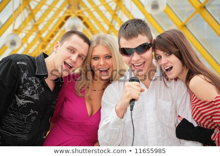 Joven micrófono puente peatonal sonrisa ventana verano Foto stock © Paha_L