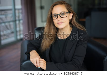 closeup portrait of a pretty young female sitting at cafe in mor stock photo © hasloo