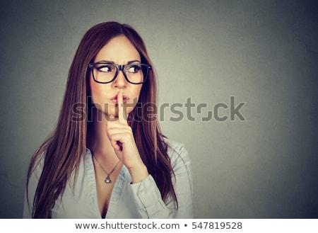 asian woman saying hush be quiet stock photo © elwynn