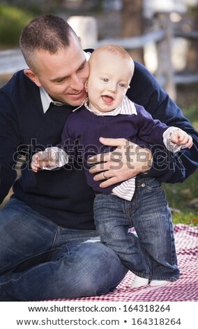 Infant Boy and Young Military Parents Play in the Park Stock photo © feverpitch