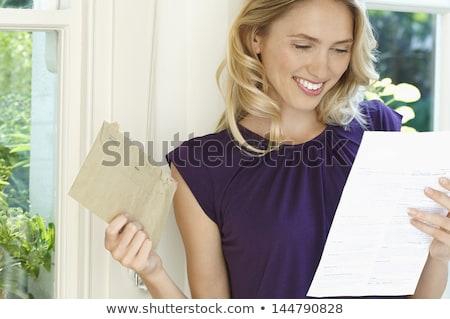 casual woman - happy letter Stock photo © dgilder