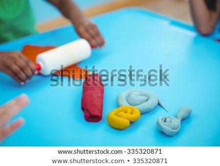Glimlachend kinderen klei bureau vrouw man Stockfoto © wavebreak_media