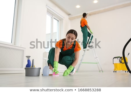 man with mop and bucket cleaning floor at home Stock photo © dolgachov
