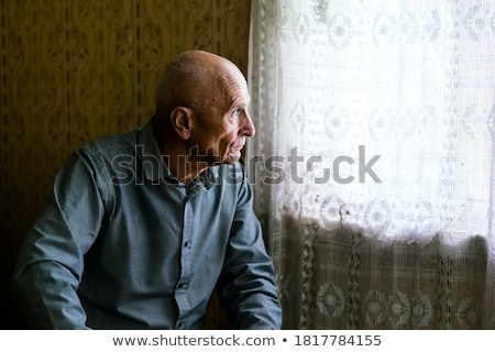 Kıdemli adam ev kanepe bir kişi Stok fotoğraf © Lopolo