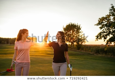 Two female golfer on green Stock photo © lichtmeister