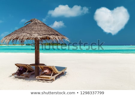 Stock fotó: Two Sunbeds Under Palapa On Maldives Beach