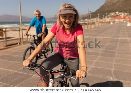 elöl · kilátás · boldog · idős · pár · lovaglás · bicikli - stock fotó © wavebreak_media