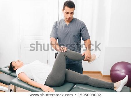 Nő fizioterápia nyújtás térd tükör nők Stock fotó © Kzenon