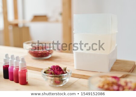 stack of large and thick bars of hard soap mass on wooden board stock photo © pressmaster