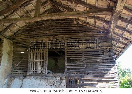 Old damaged wall fixing in vintage barn Stock photo © simazoran
