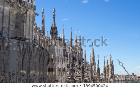 Scaffolding on the roof of the cathedral of Milan Duomo. Stock photo © ShustrikS