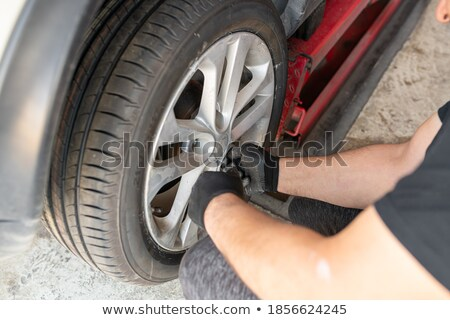 A man who changing a Car Tire Stock photo © Lopolo