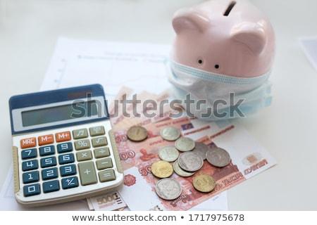 Piggy Bank With Ruble Banknotes Stock photo © albund
