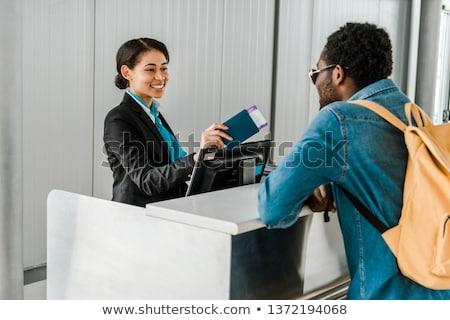 happy woman with air ticket, passport and bacjpack Stock photo © dolgachov