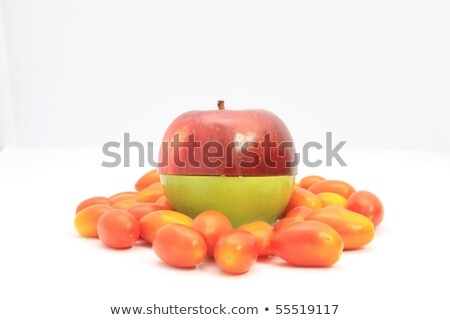 Stock photo: Apple red on green and tomato (haft)