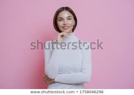 Jonge mooie vrouw tevreden kin glimlacht rechtdoor Stockfoto © vkstudio