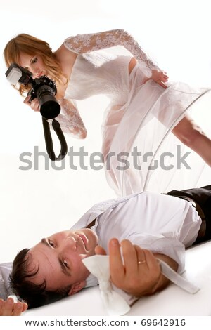 photographer taking picture of woman laying on floor stock photo © icefront