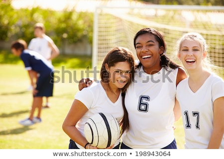 Smiling teenage sports girl with soccer ball stock photo © darrinhenry